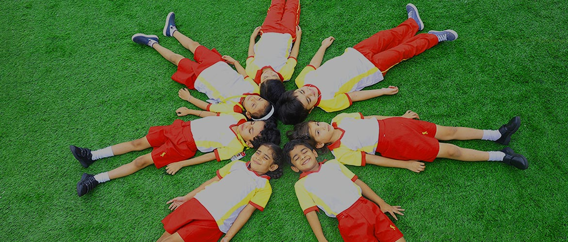 Students of Canary high International School Lying down on the ground