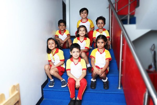 A Students of Canary High International School in Pune Sitting on a Staircase of the school