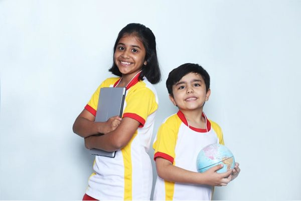 A boy and a girl Standing with a ball and a laptop in their hand